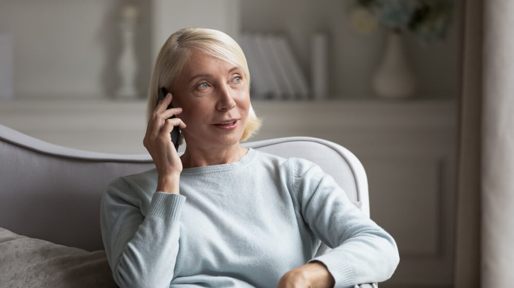 older woman conducting a phone interview