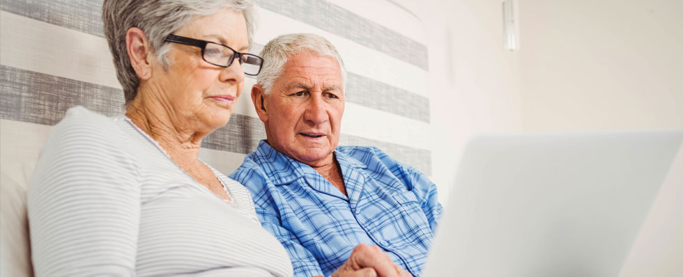 Retired couple at computer